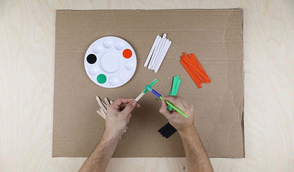 Halloween Lollipop Sticks - Using your paint brushes paint; 8 lollipop sticks Orange, 8 White, 4 Green and 5 Black